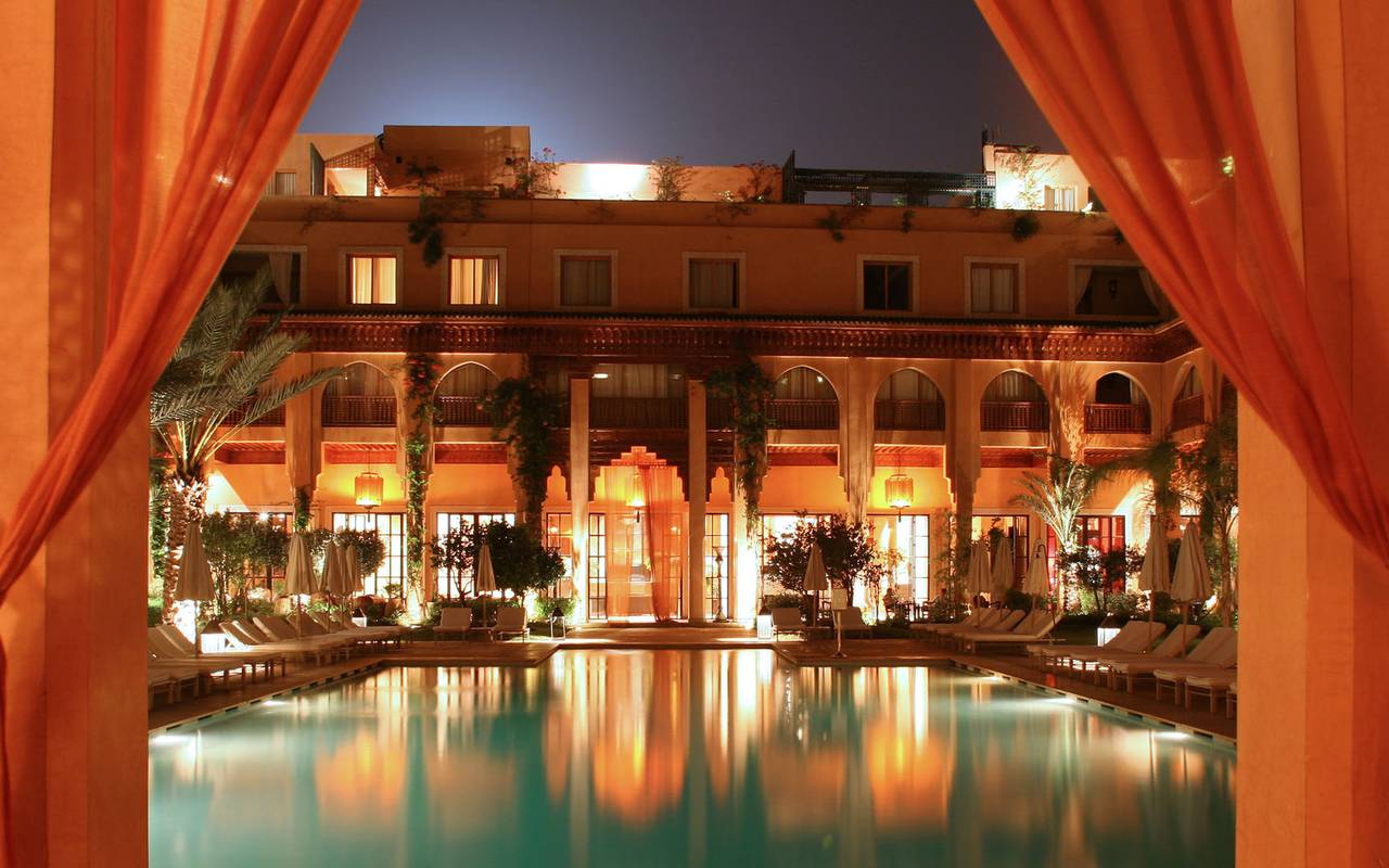 luxurious swimming pool patio by night Koutoubia Marrakech